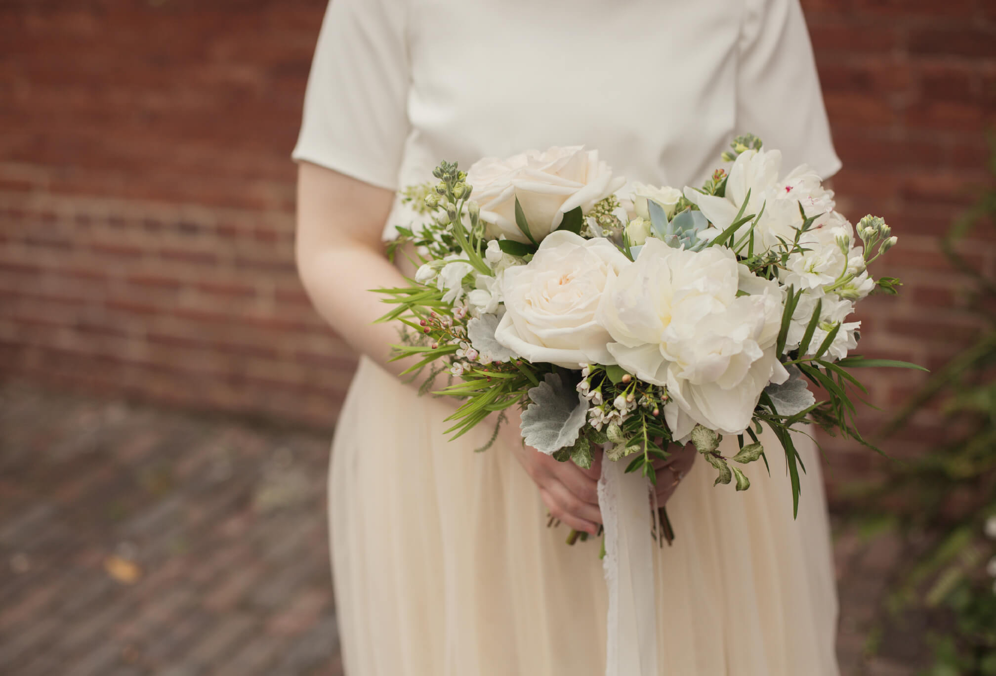 bride bouquet white green