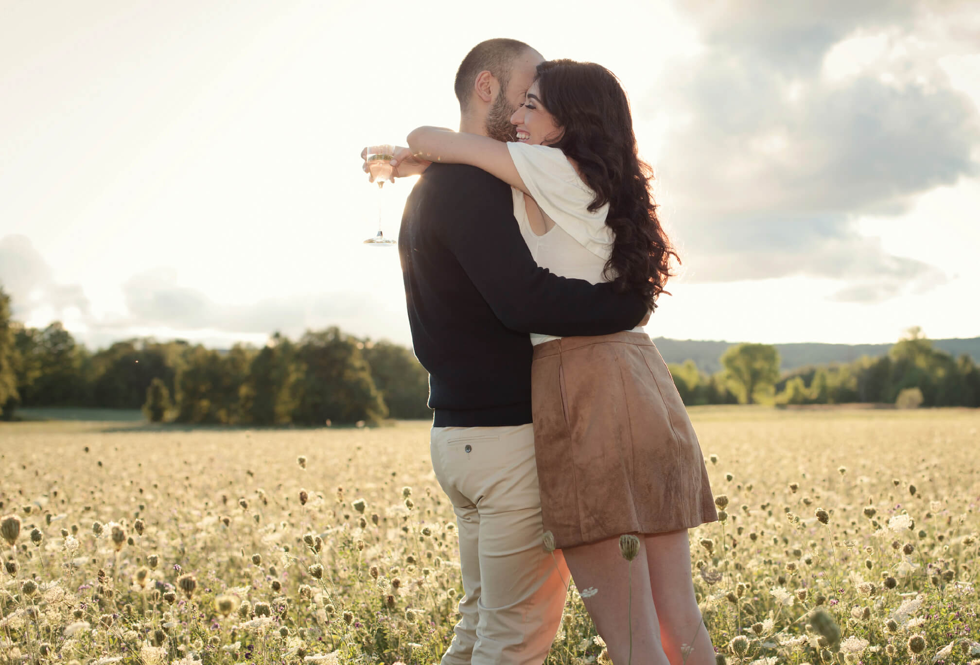 couple hugging in a field ontario