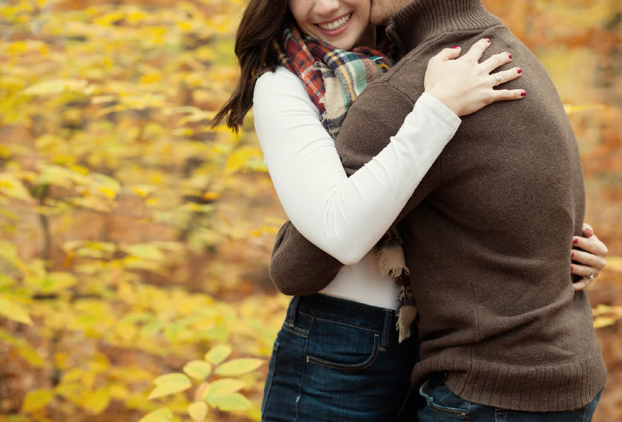 couple laughing fall engagement