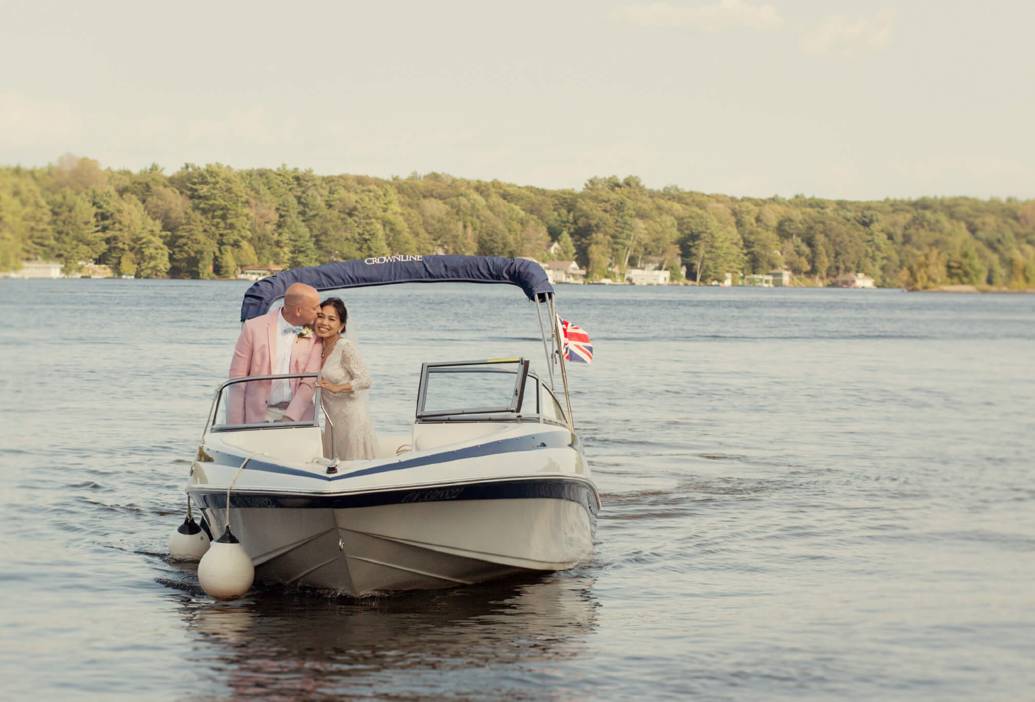 cottage wedding bride and groom on boat
