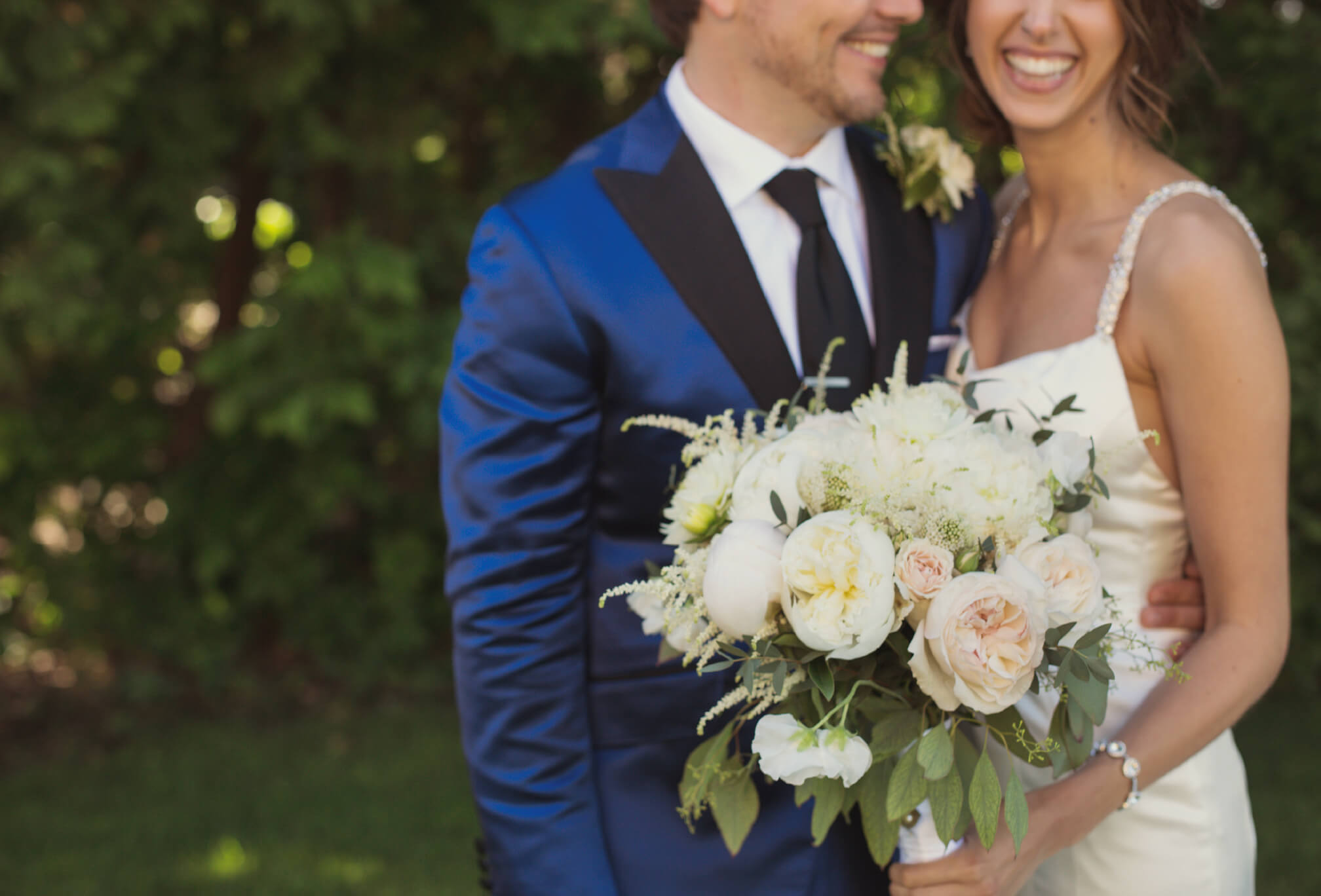 groom blue tux bride laughing