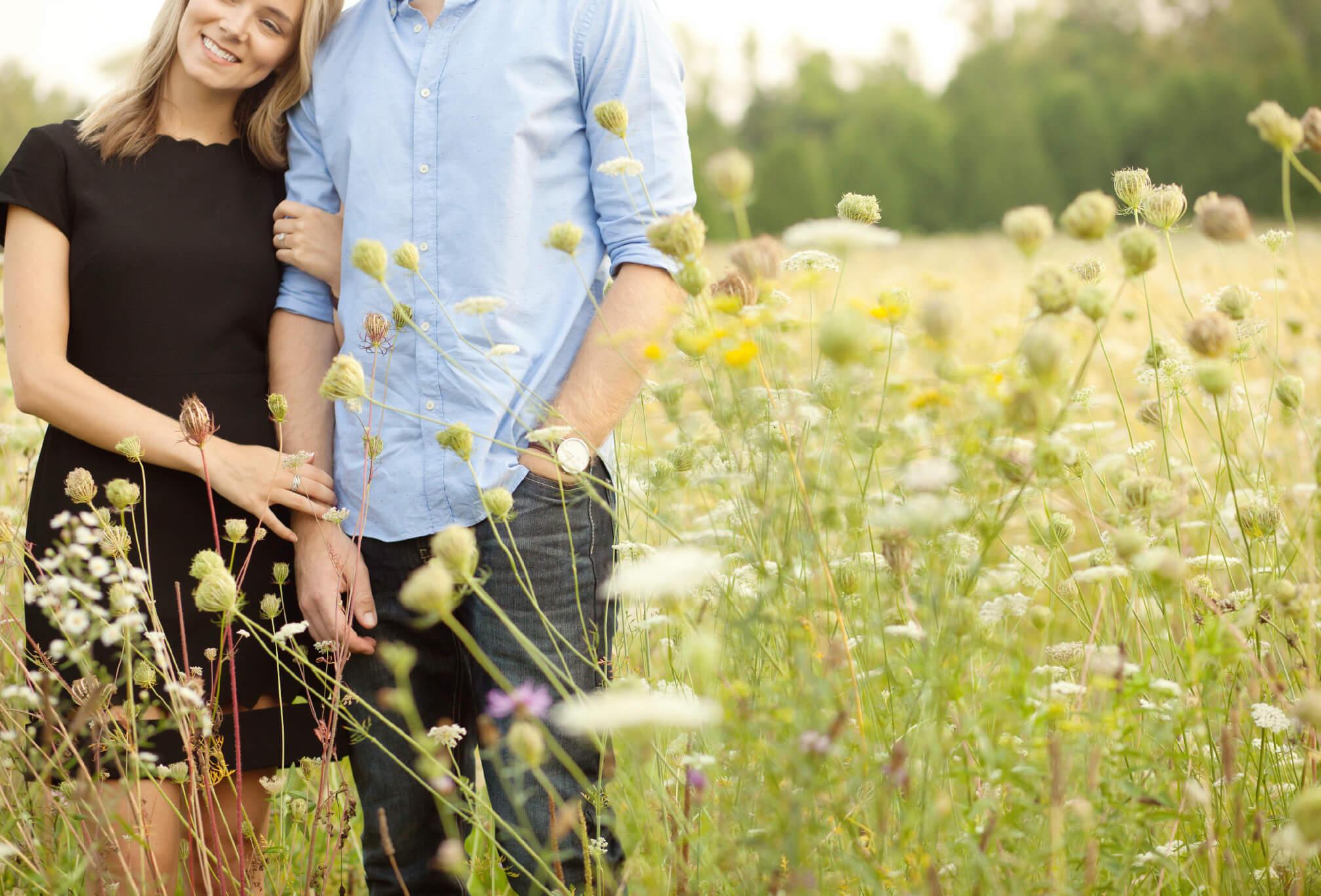 couple in wildflower field