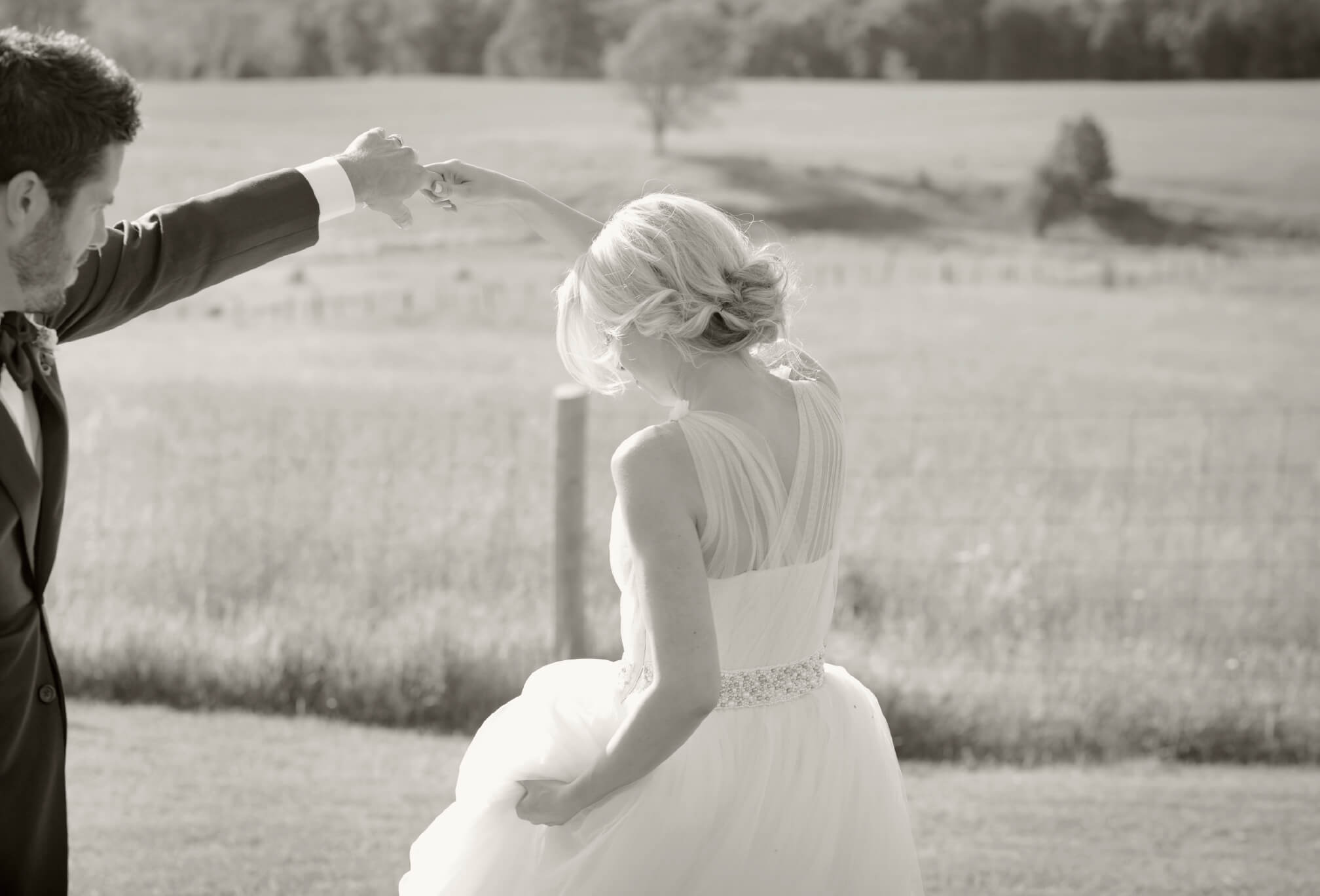 dancing in a field bride and groom