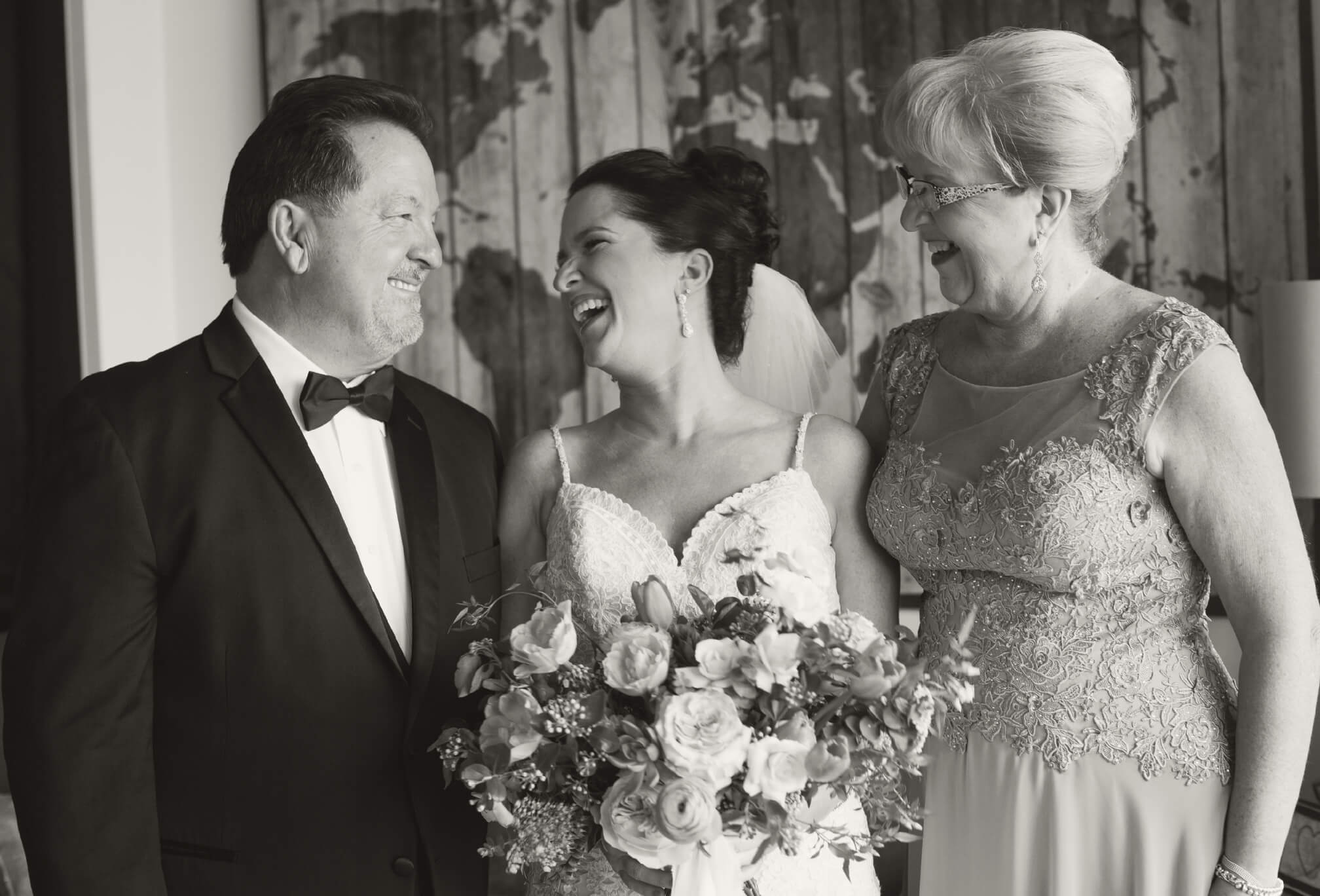laughing bride and parents