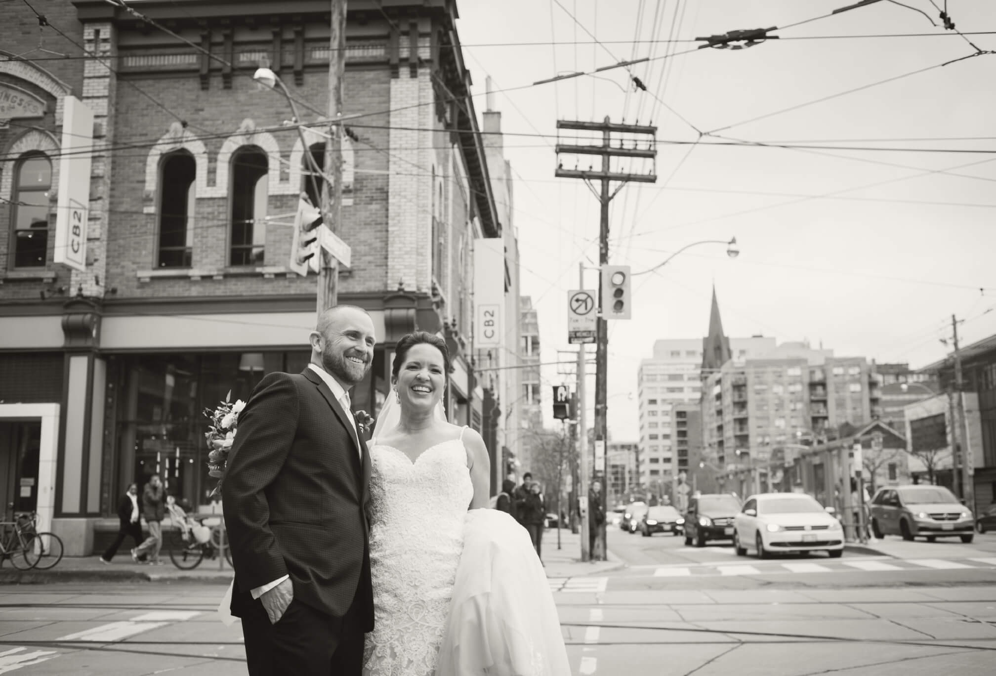 bride and groom laughing queen west