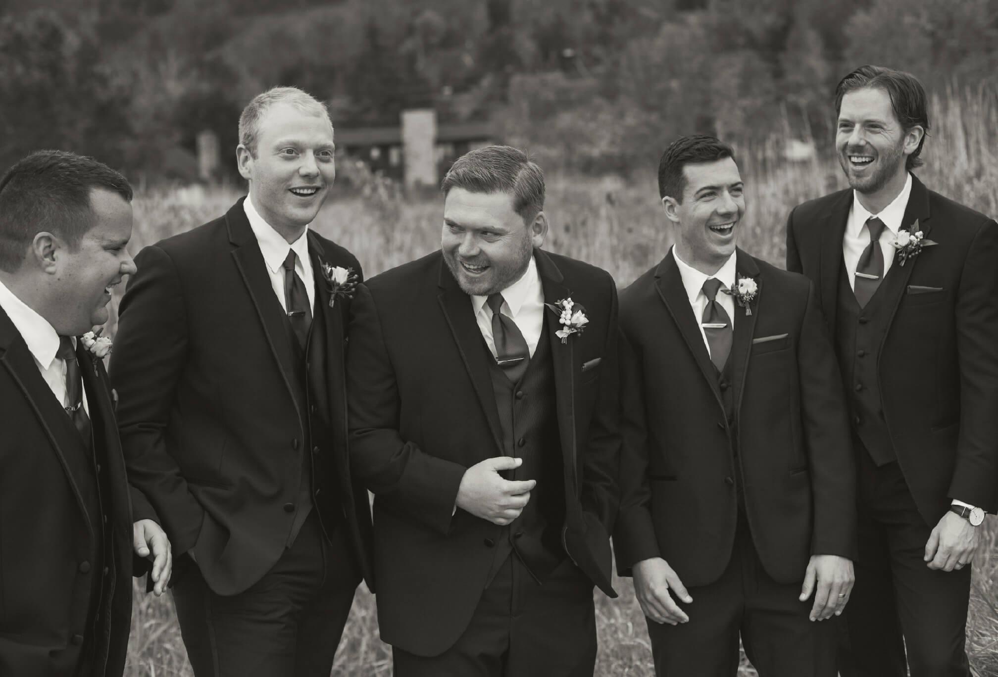 groom laughing with groomsmen