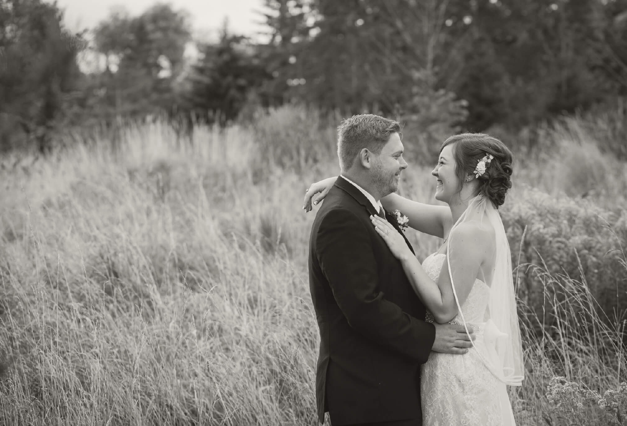 bride and groom in field craigleith