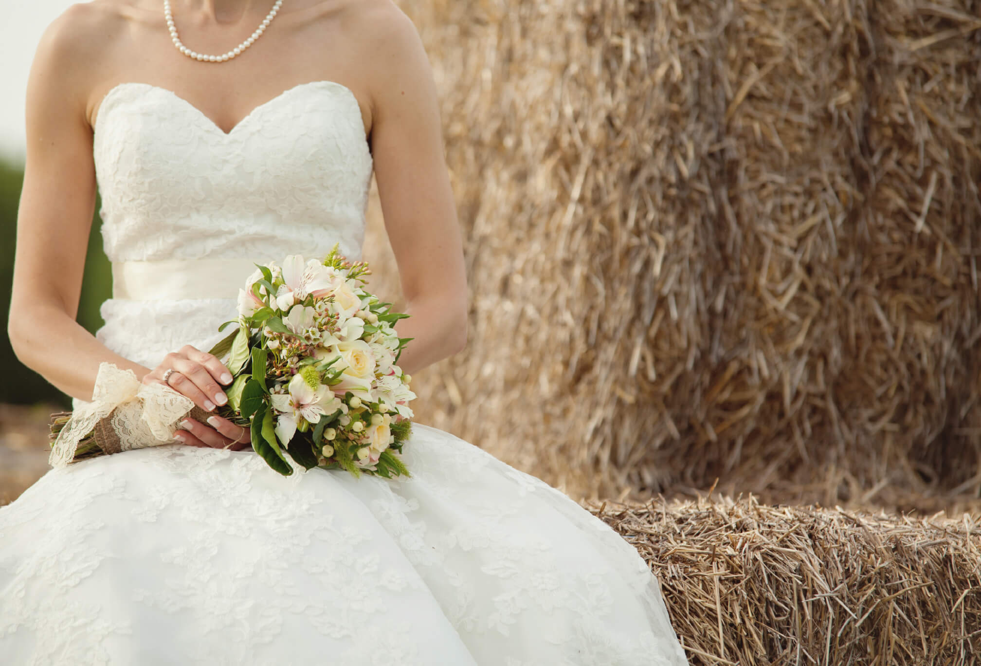 bride on hay stack