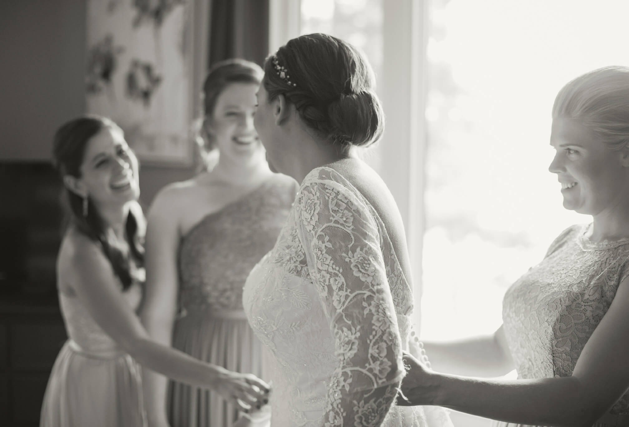 bride getting ready at cottage