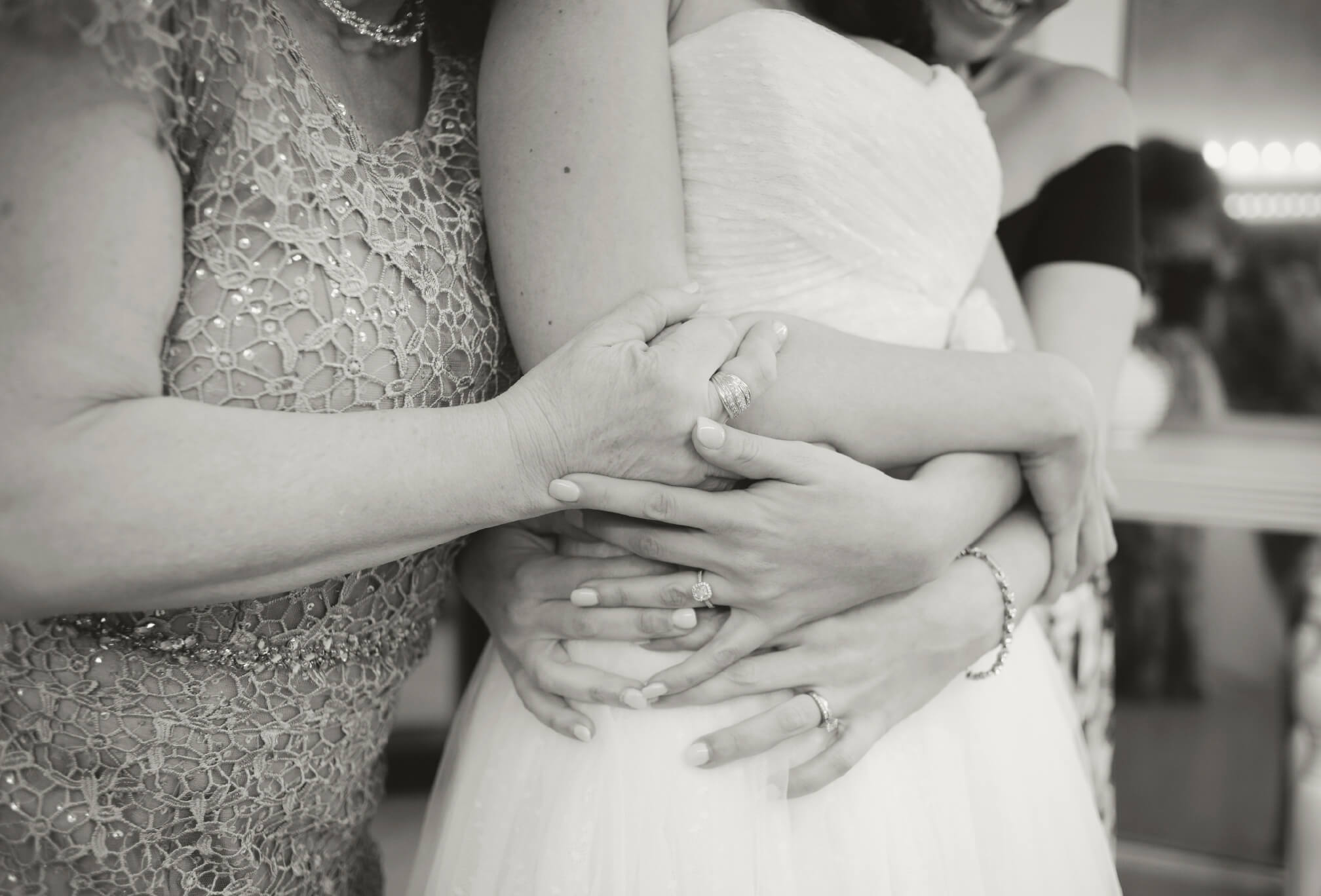 bride mom and sister hug