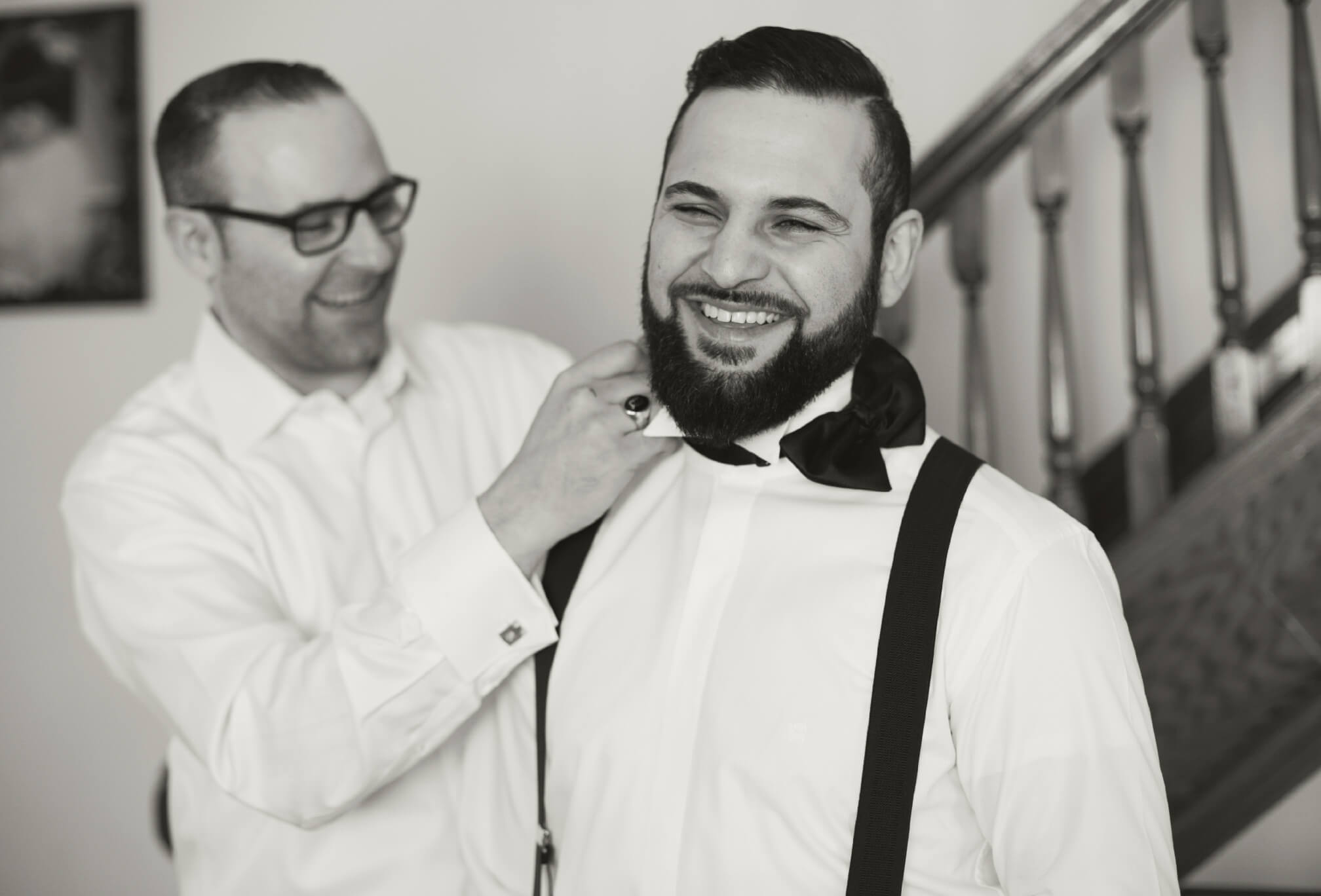 groom and brother getting ready