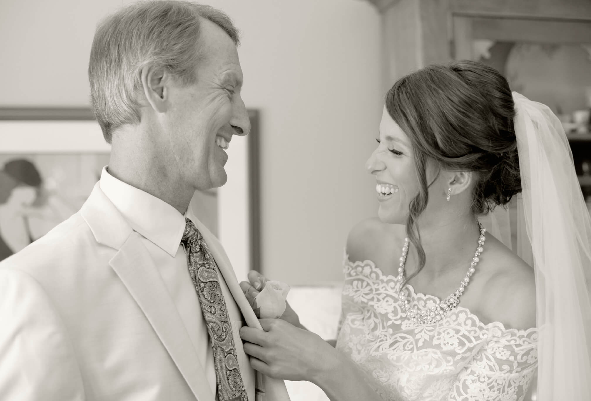 bride and dad laugh