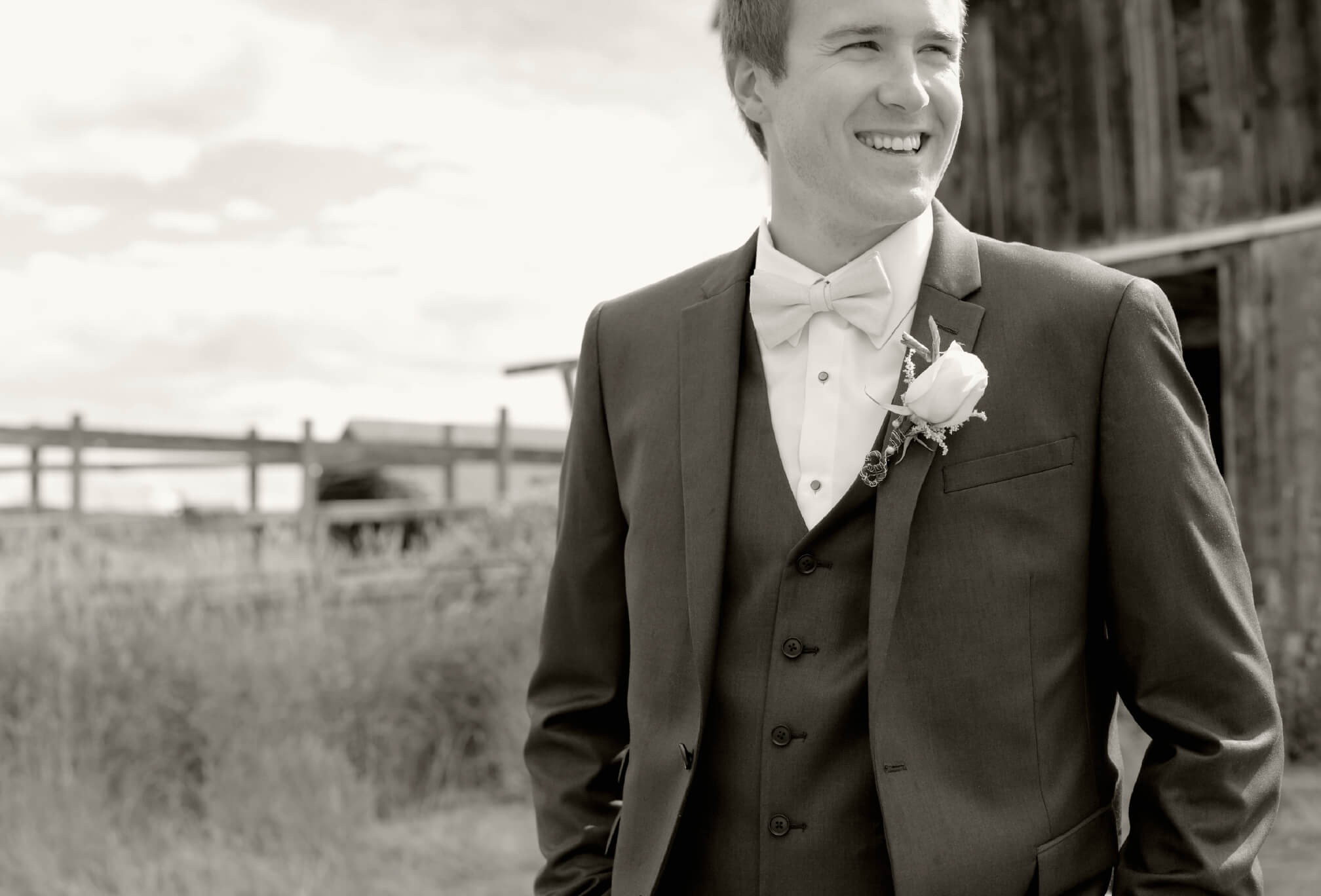 black and white groom with barn collingwood