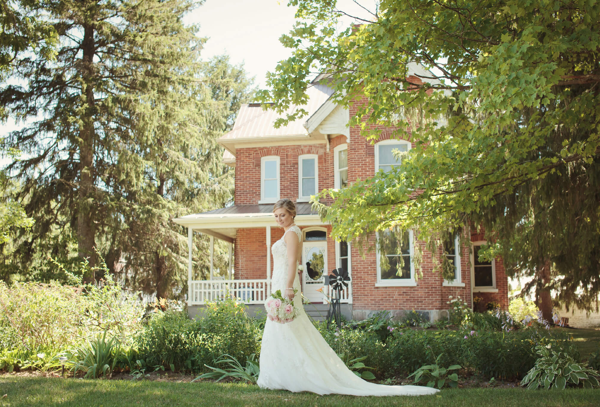 bride walking in front of farmhouse