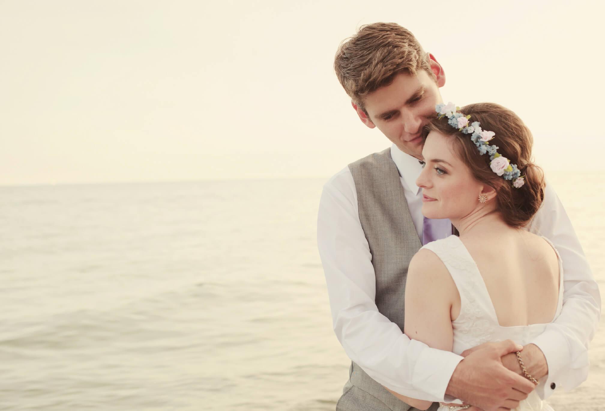 bride and groom on beach toronto sunset
