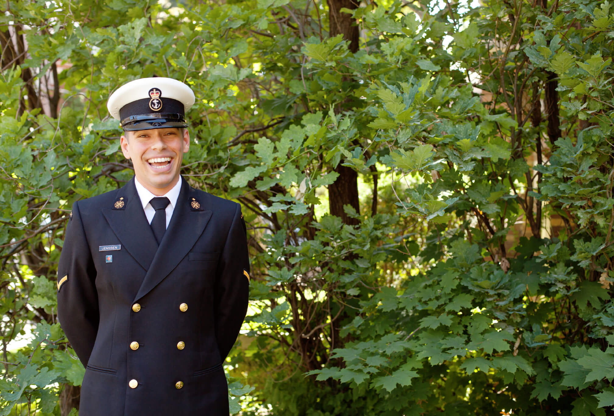 laughing navy uniform groom