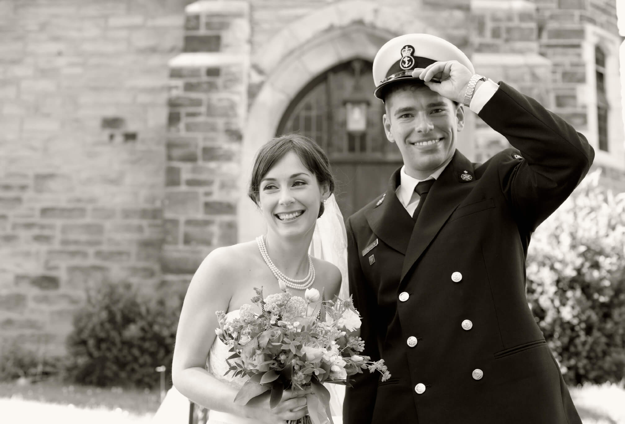 bride and groom in navy uniform