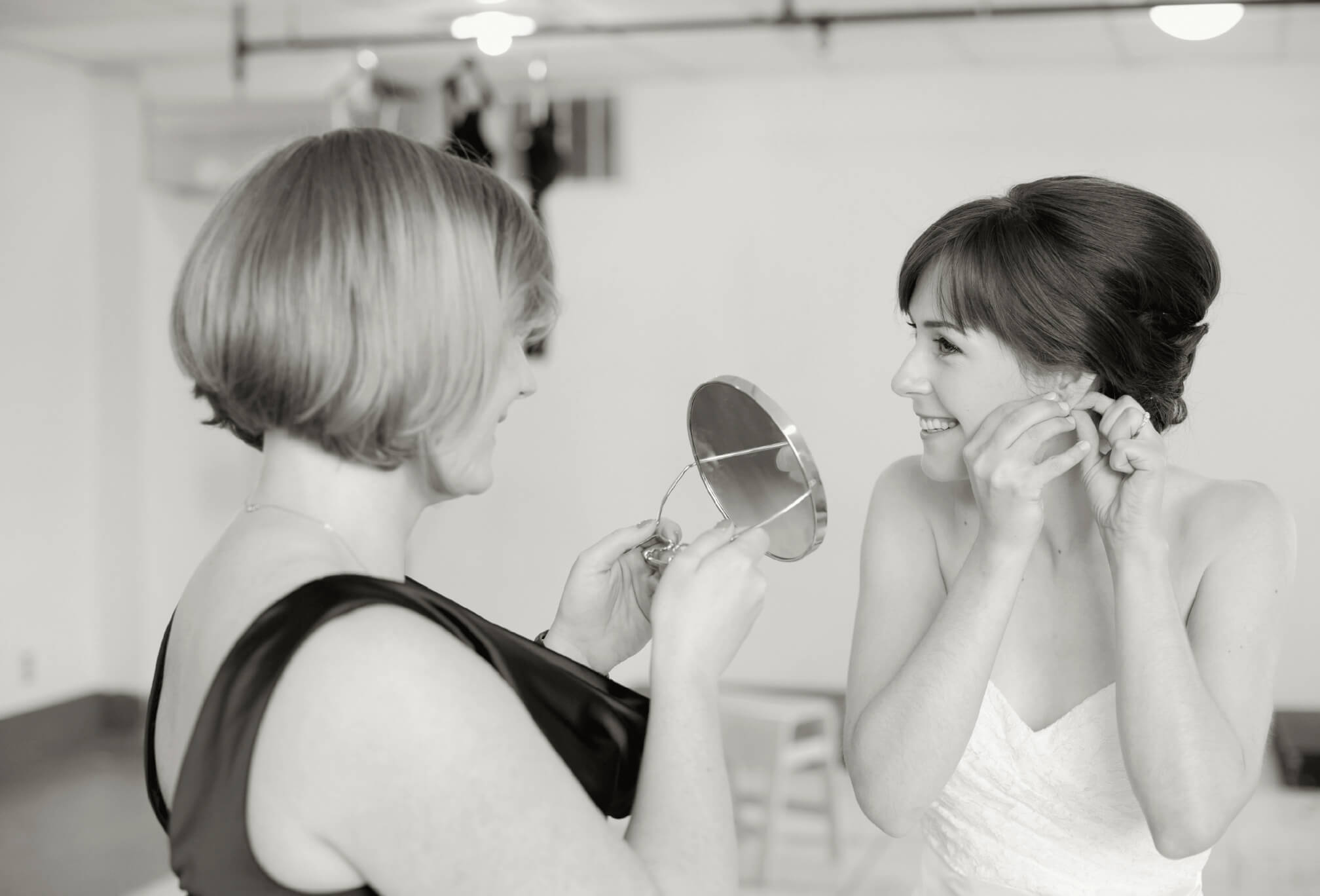 bride getting ready best friend