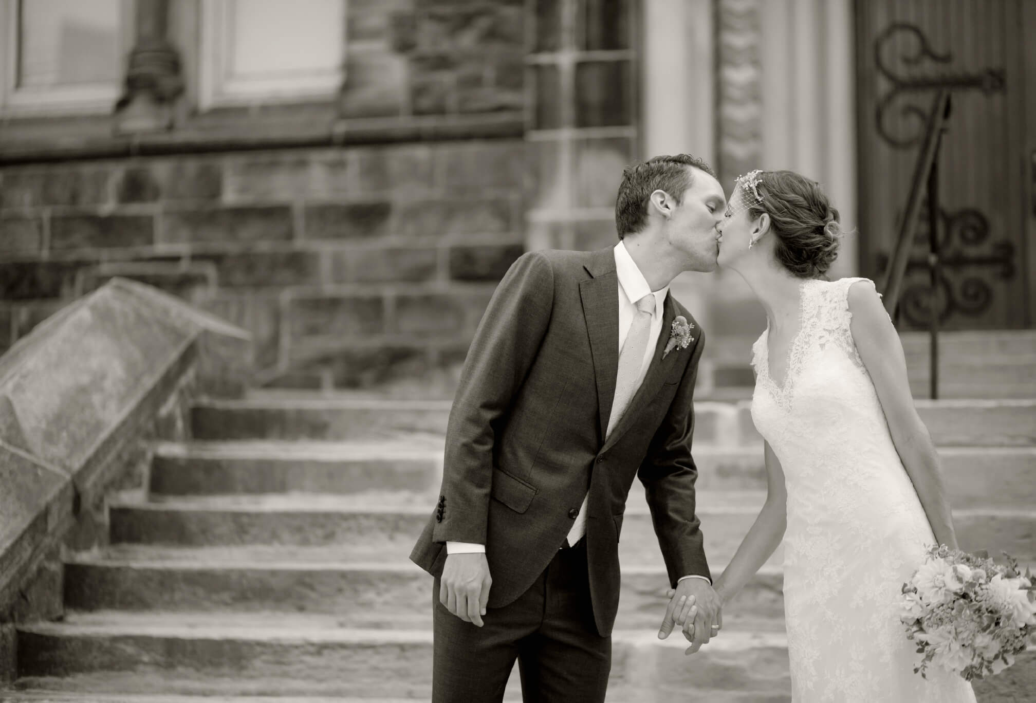 bride and groom black and white kissing hart house