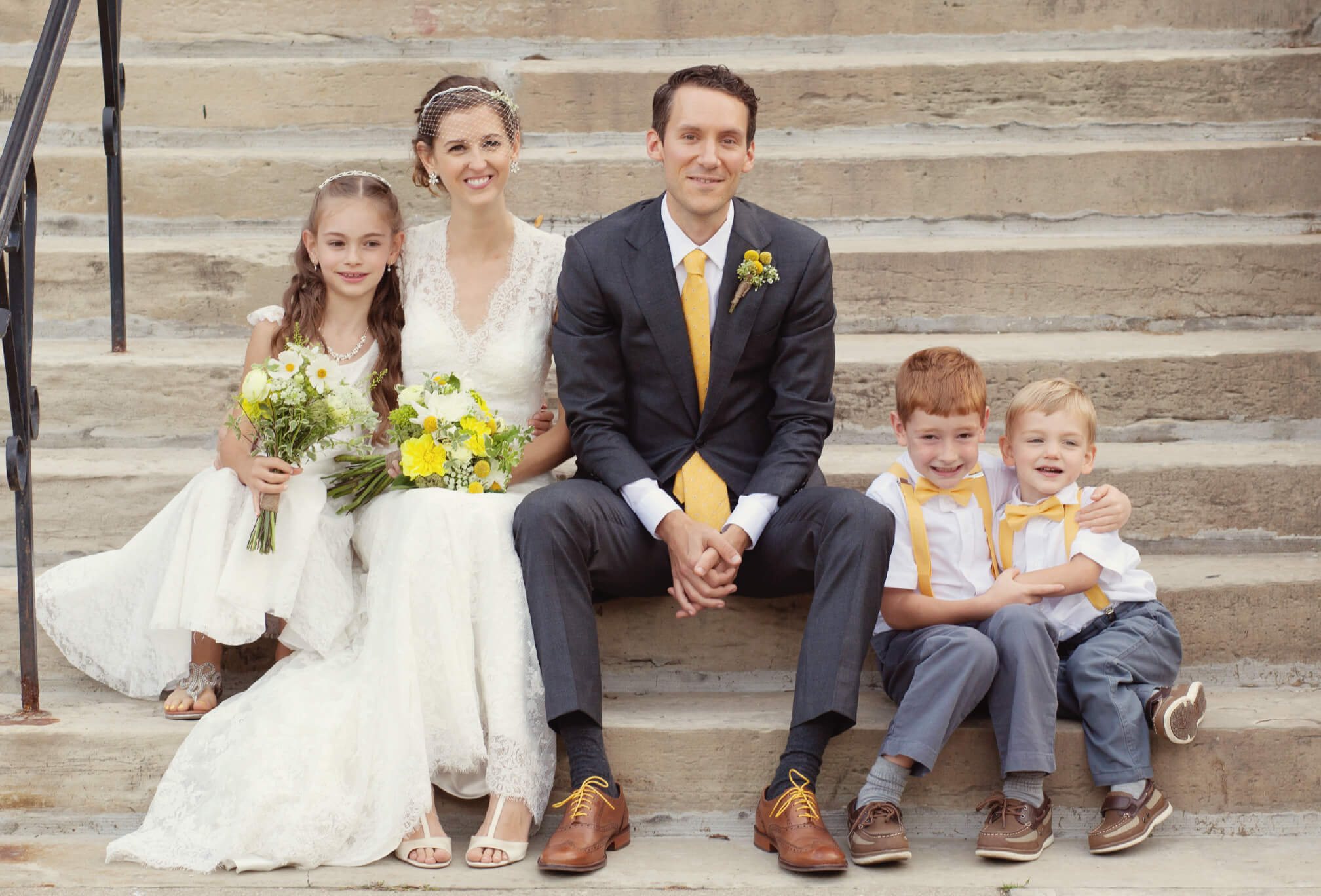 bride and groom sitting with kids hart house