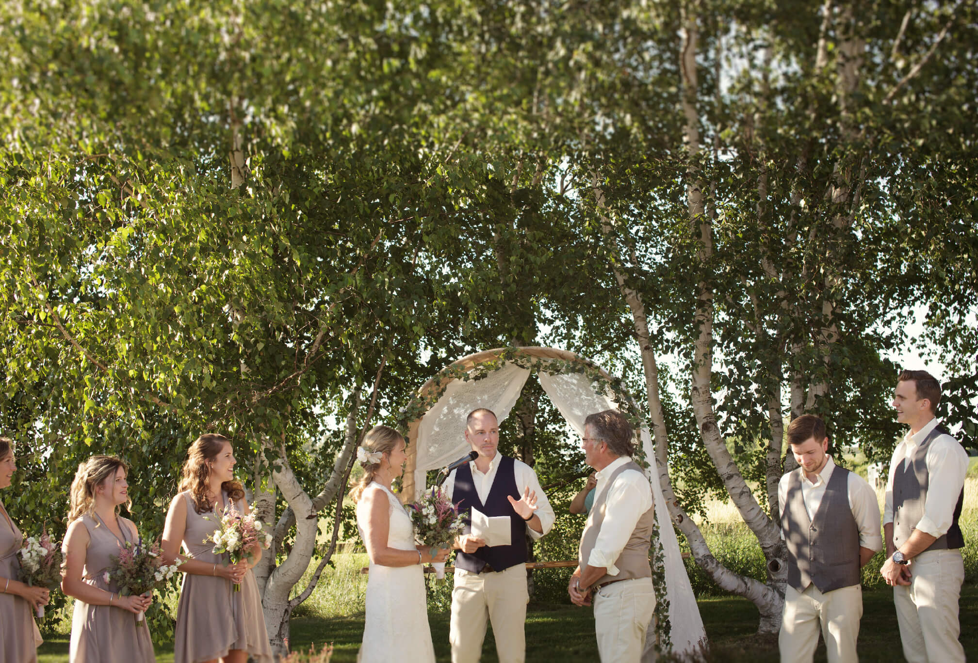 outdoor ceremony among birch trees