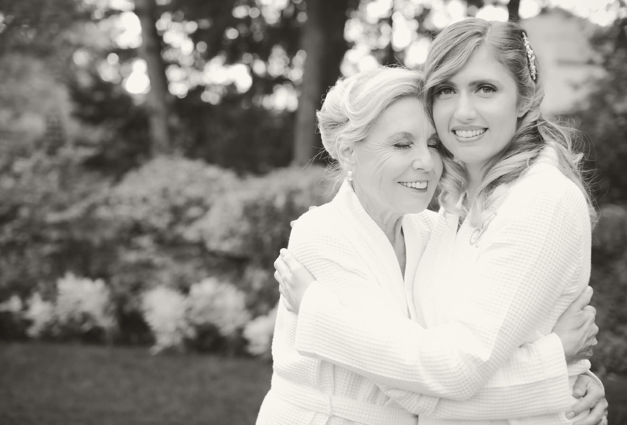 candid bride and mom moment