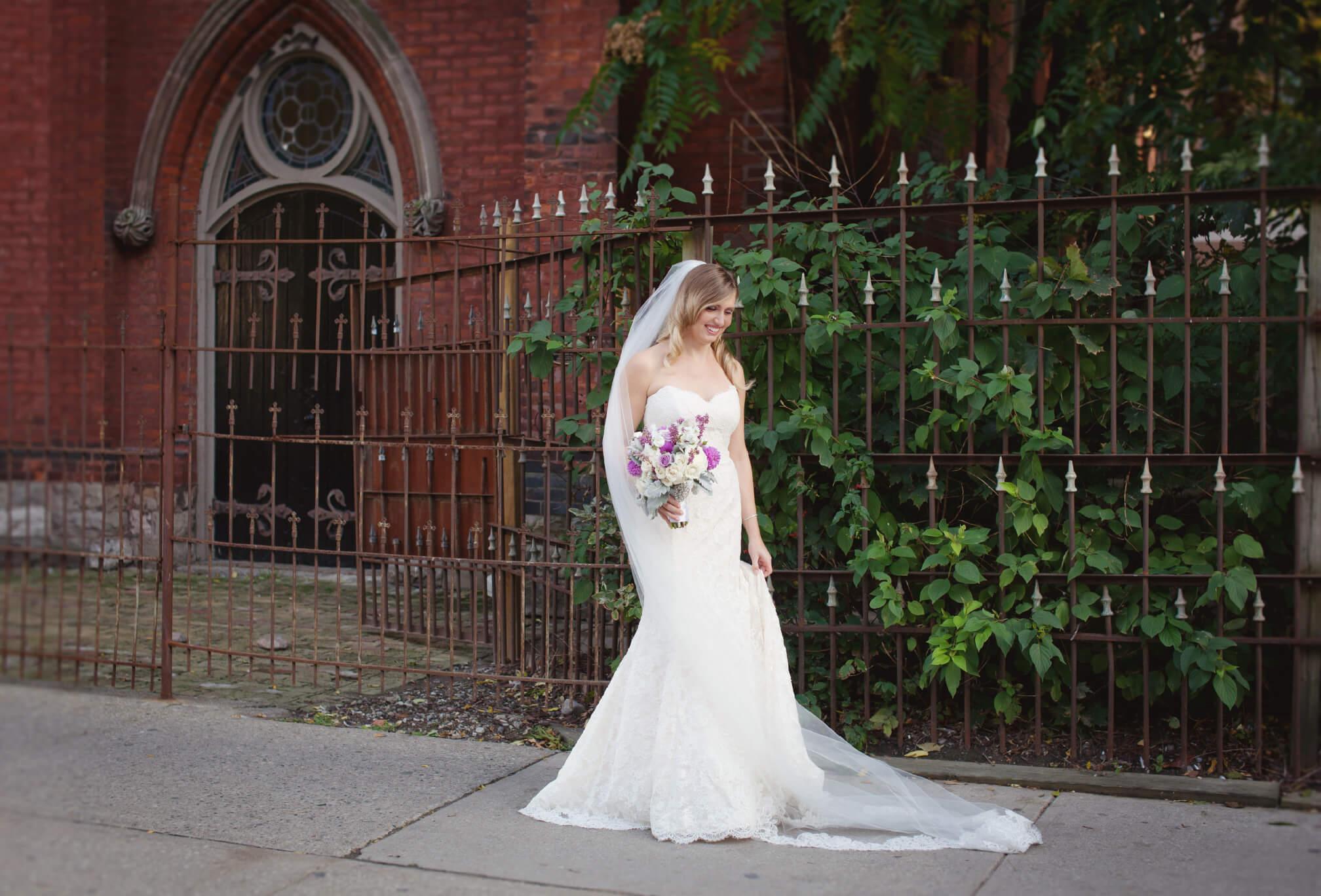bride posing outside berkeley field house