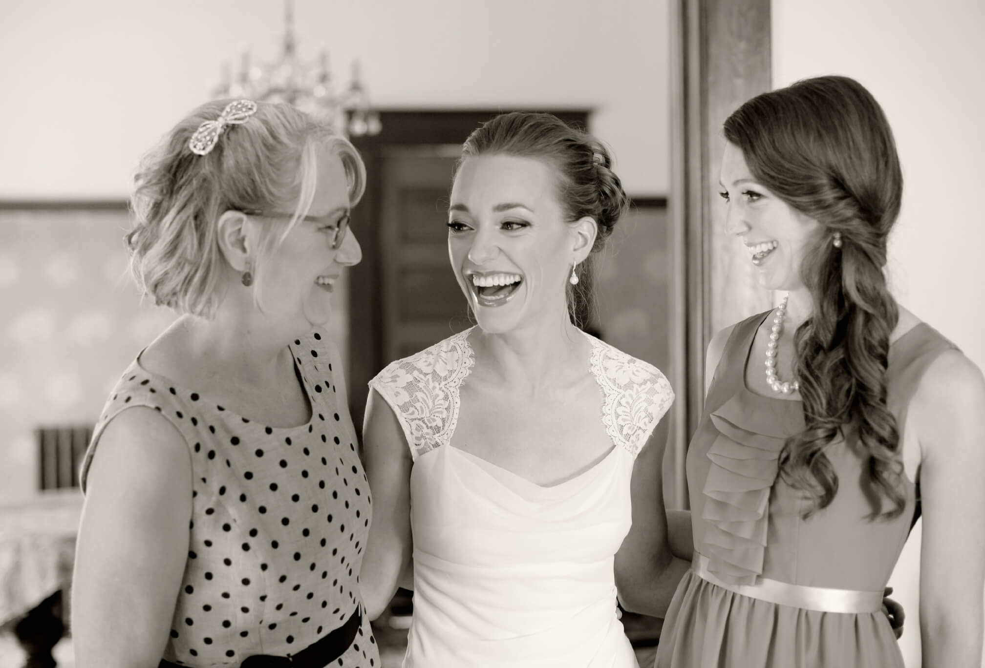 bride and mom laughing