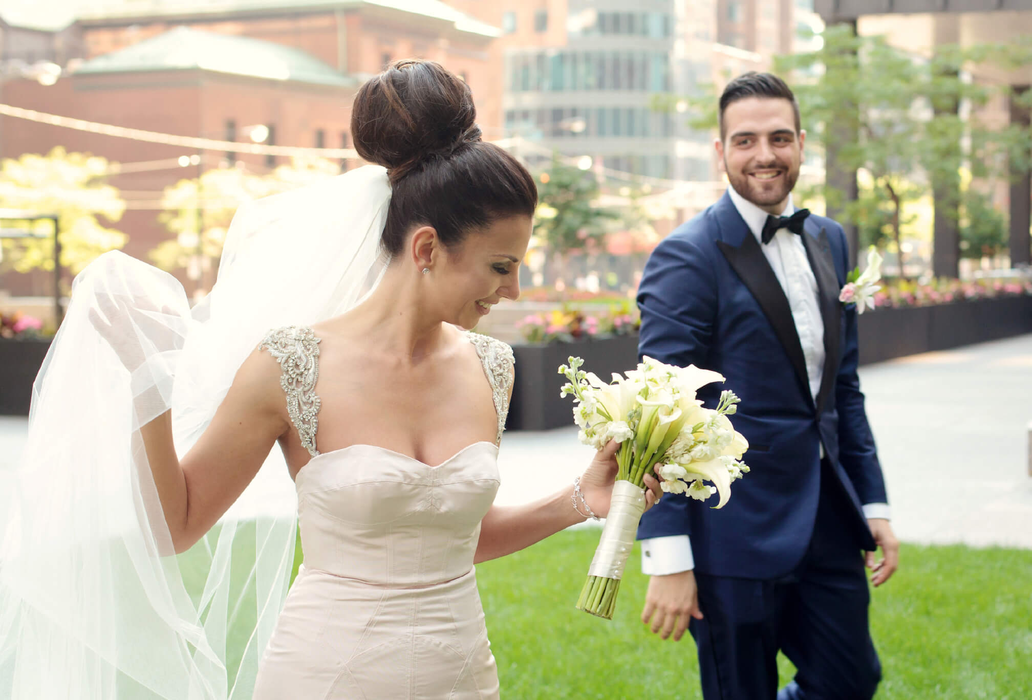 candid bride and groom outside manulife building