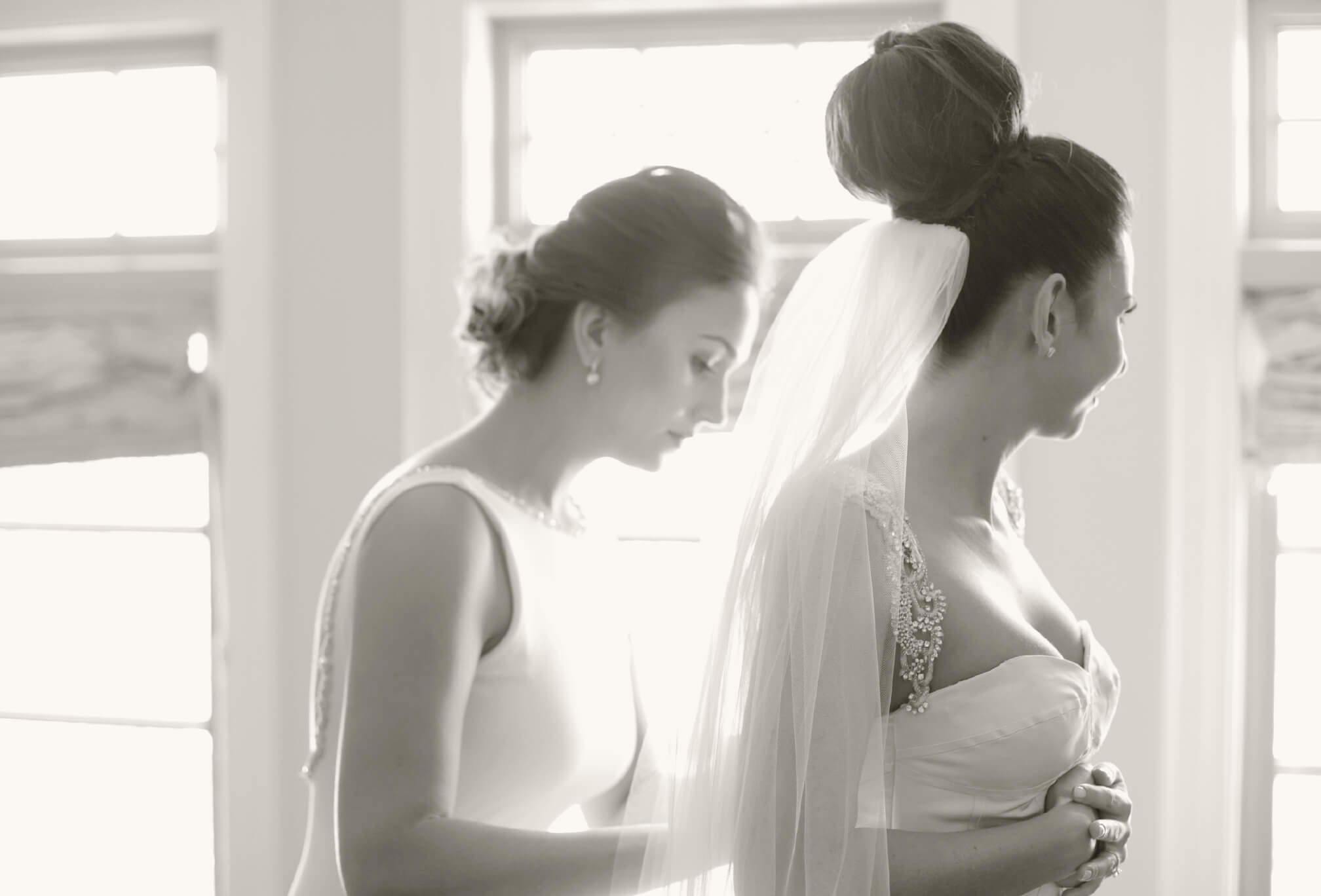 bride and sister getting ready