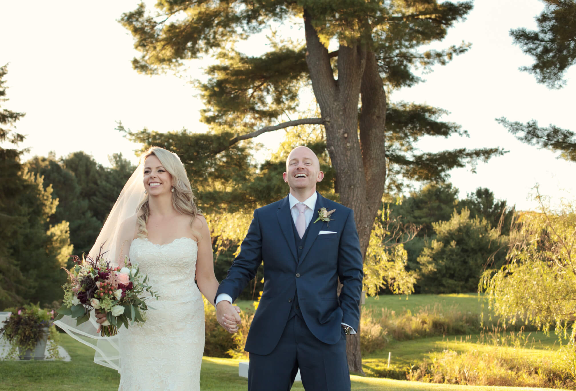 bride and groom laughing muskoka wedding