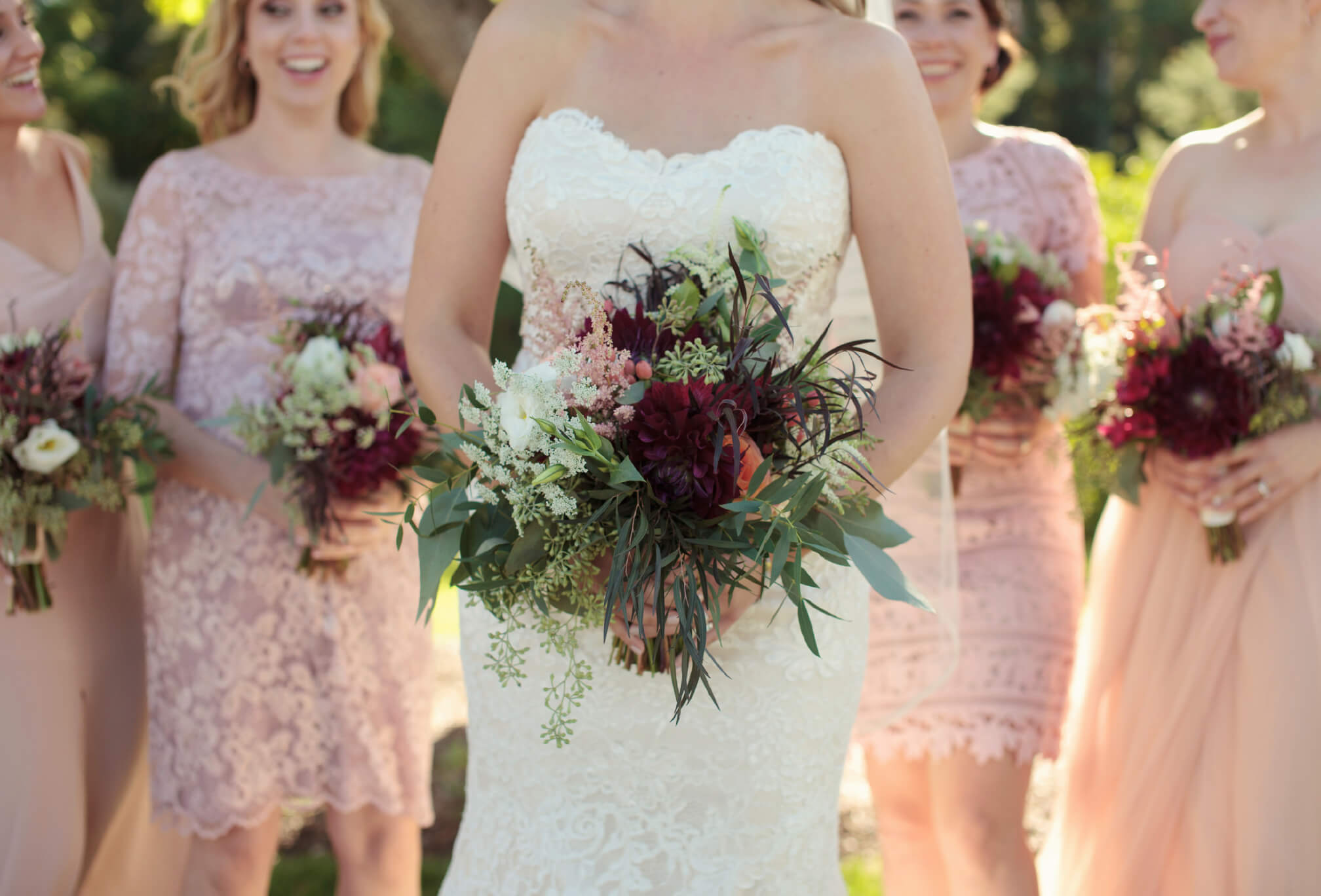 pink wedding bouquet and bridesmaids