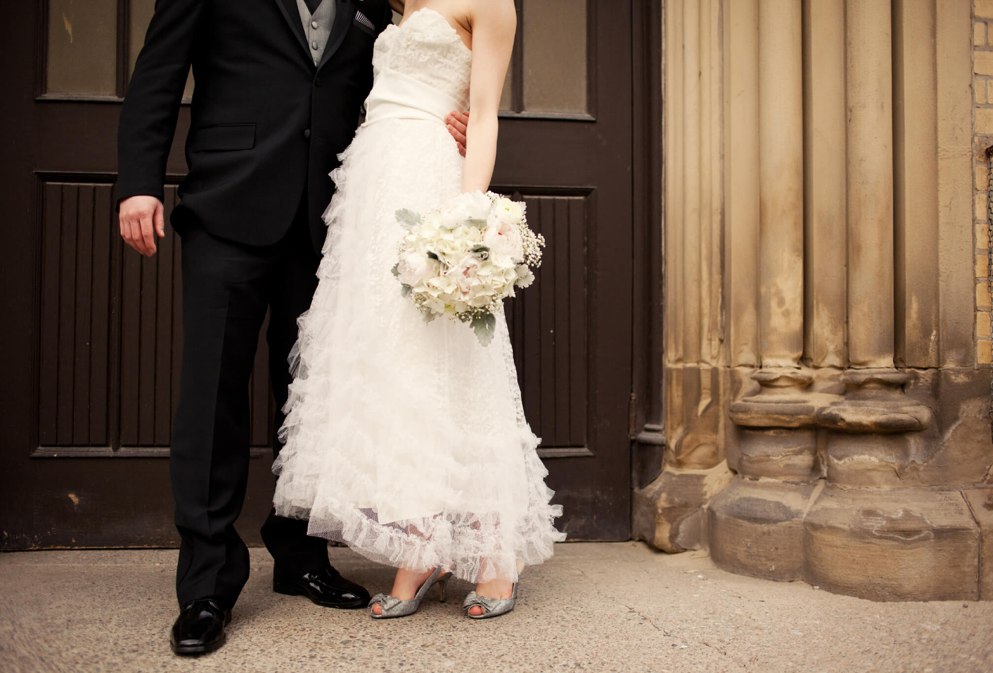 vintage bride and groom style detail lace dress and bouquet