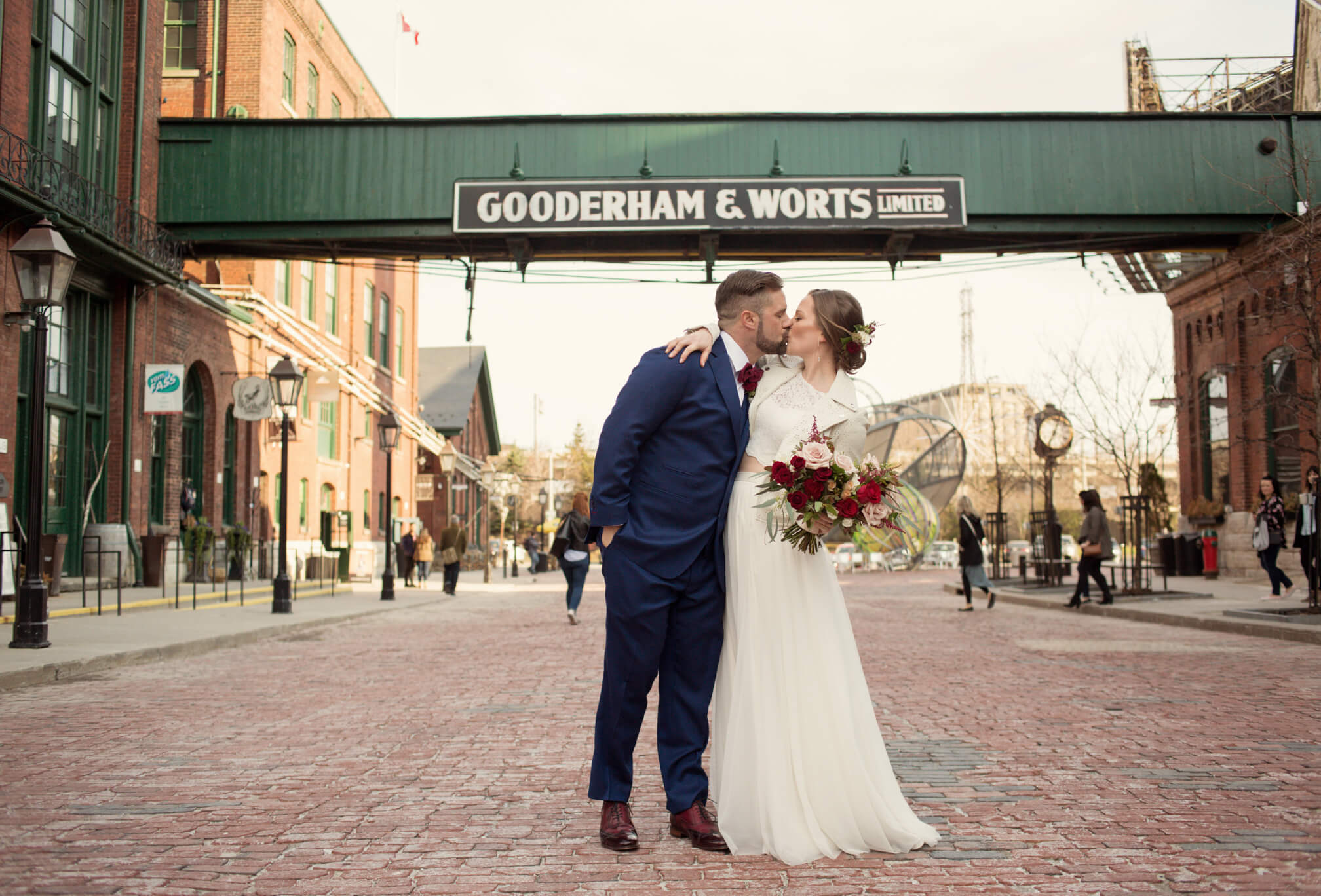 kissing at distillery district wedding