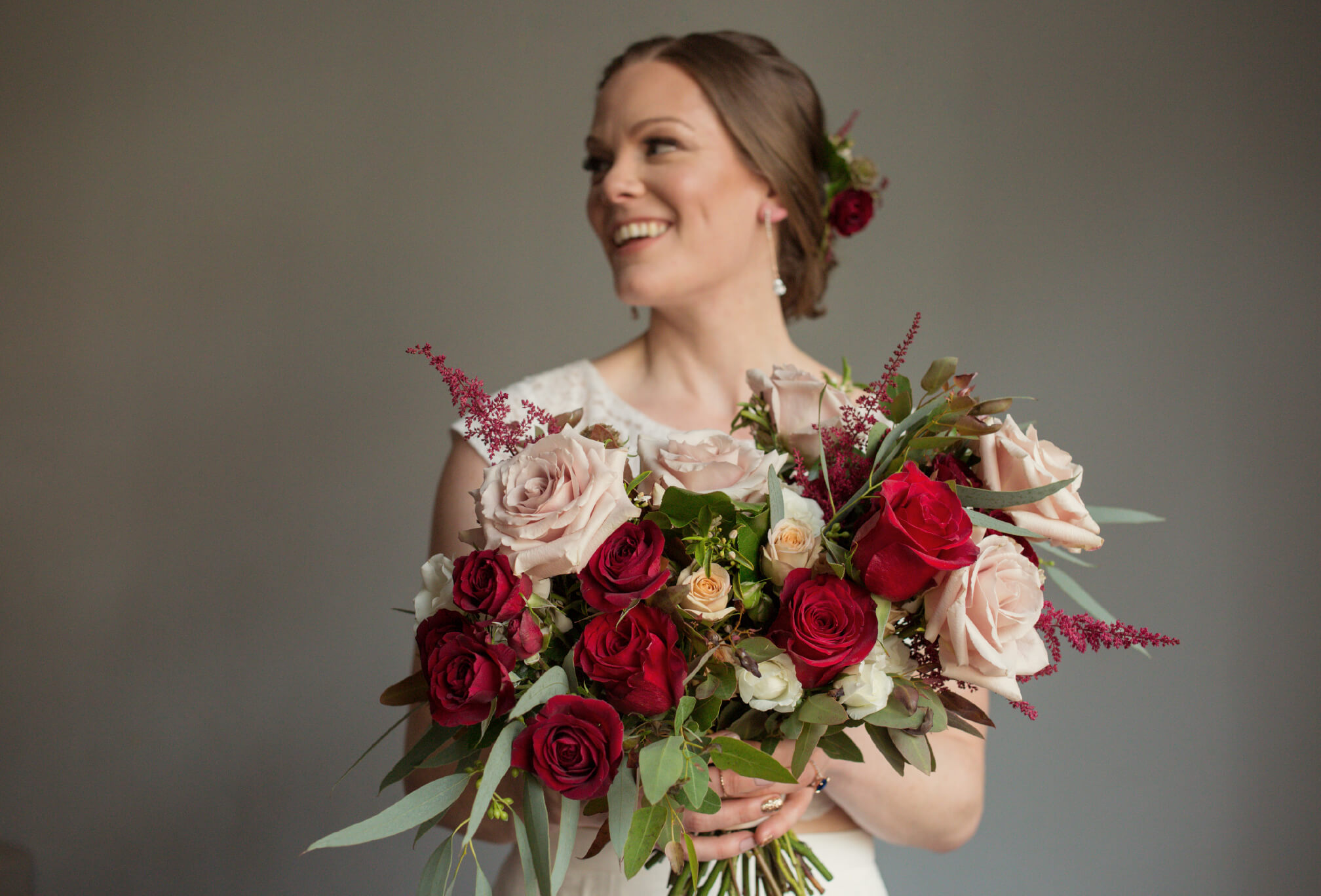 bride with red rose bouquet toronot