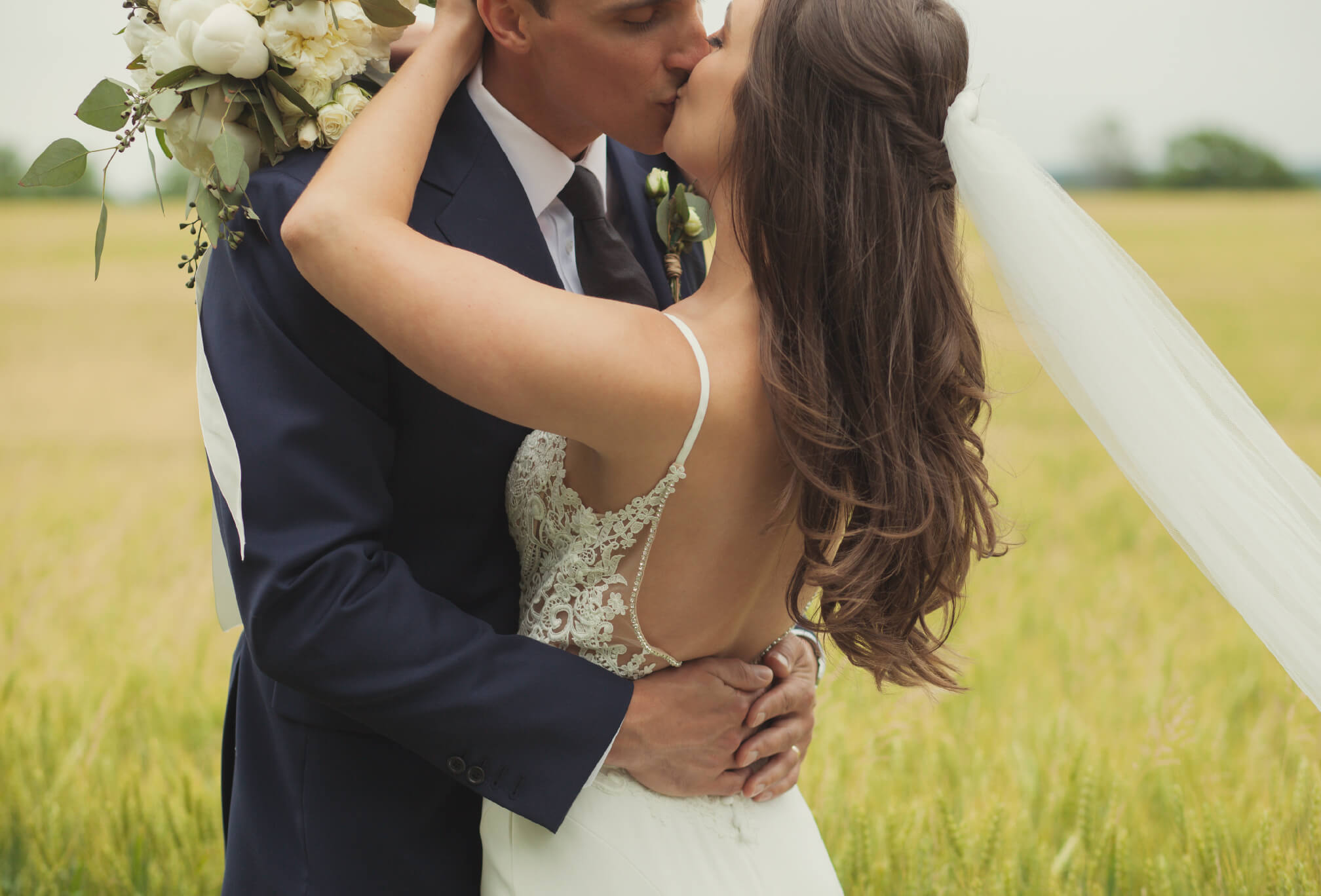 bride and groom kissing details