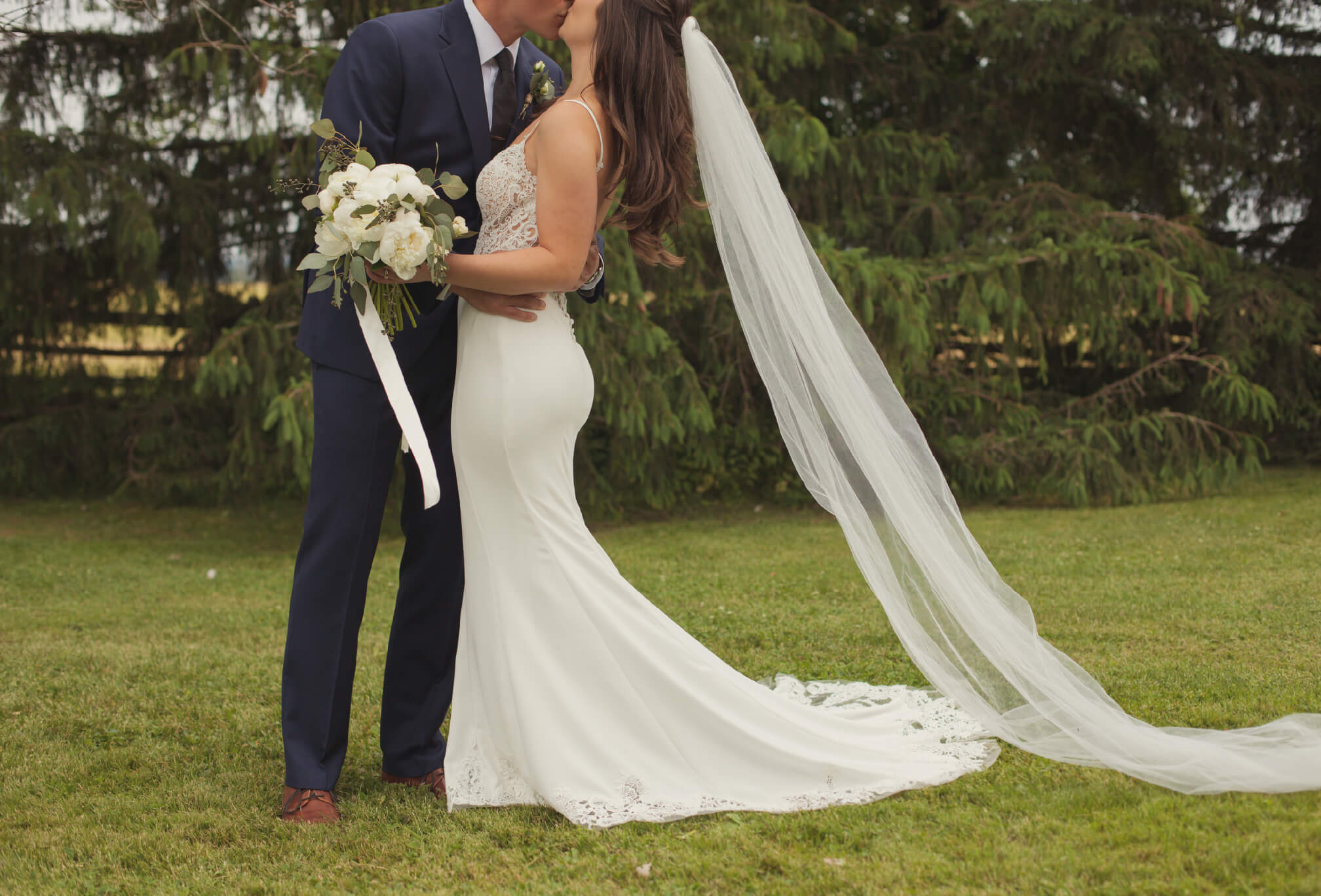 bride and groom details blue suit