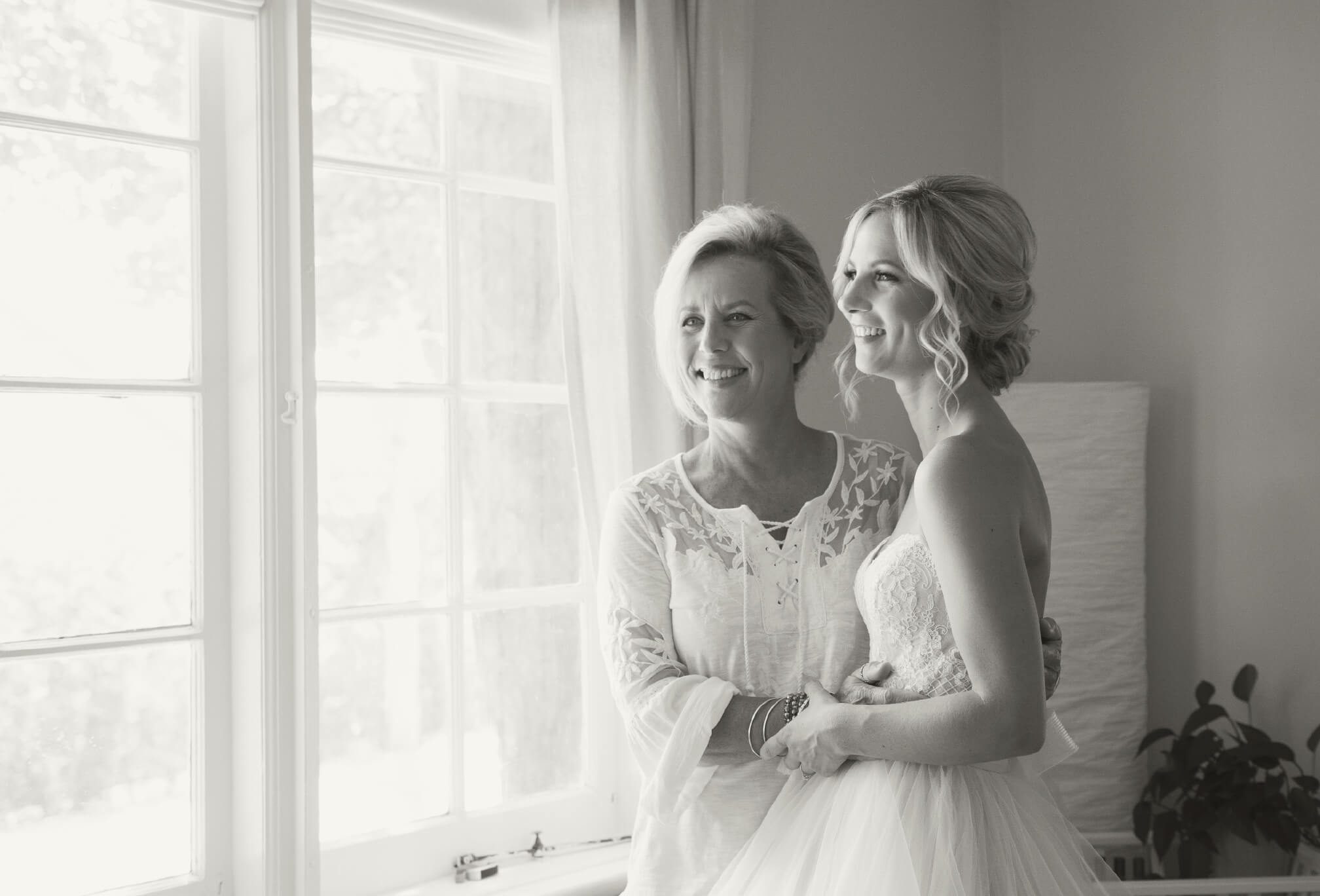 candid black and white bride and mom