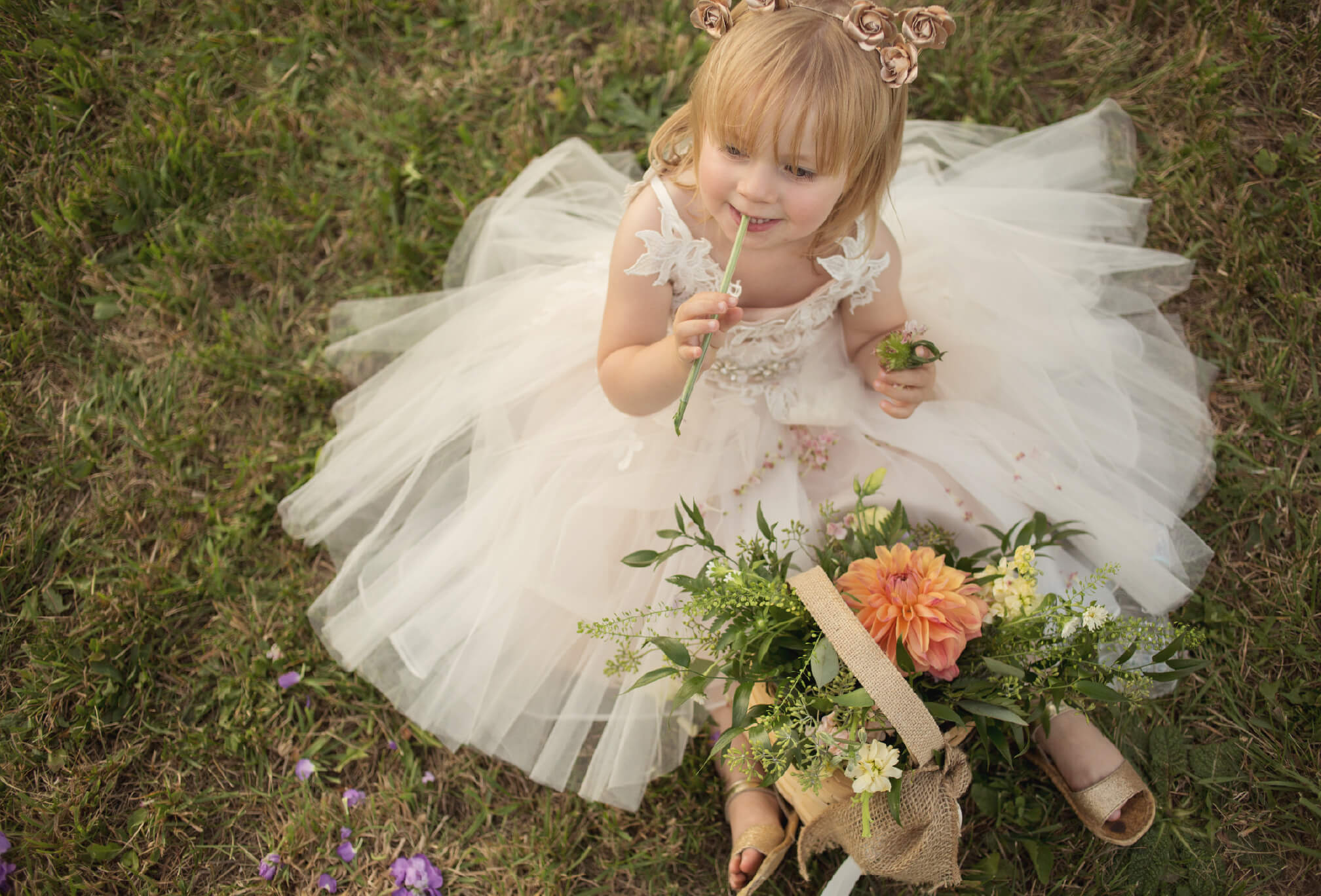 adorable flower girl with flowers