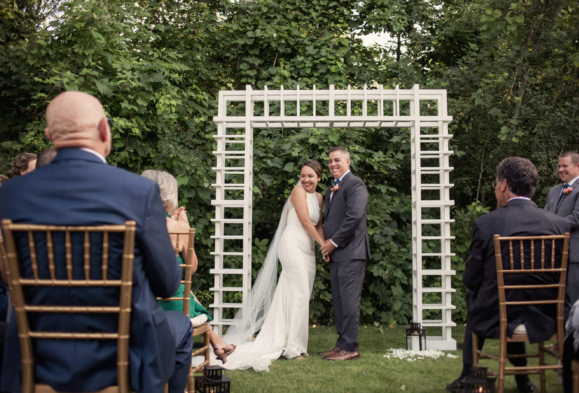 bride and groom intimate backyard ceremony