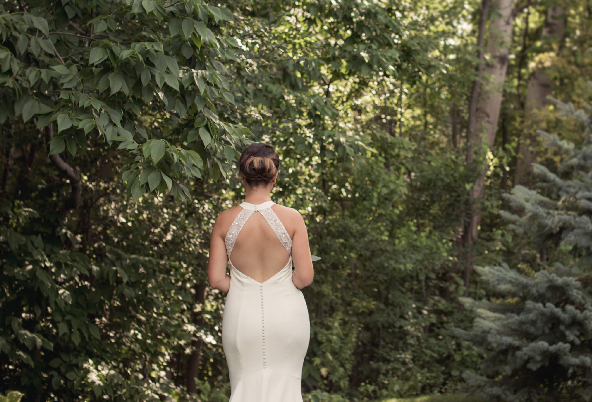 bride backless dress in forest
